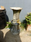 A CARVED STONE COLUMN