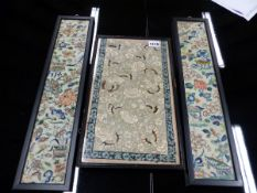 THREE CHINESE SLEEVE PANELS VARIOUSLY SILK EMBROIDERED WITH FLOWERS, BUTTERFLIES, PAVILIONS AND