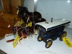 THREE SHIRE HORSE FIGURES AND A MODEL STEAM TRACTION ENGINE.