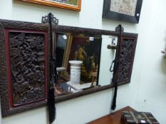 A BEVELLED GLASS RECTANGULAR MIRROR CENTRAL TO CHINESE HARDWOOD PANELS CARVED WITH WARRIORS ALL WITH