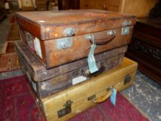TWO LEATHER AND A LARGER VELLUM SUITCASE