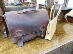 AN OSTRICH SKIN HANDBAG TOGETHER WITH A LEATHER BRIEF CASE