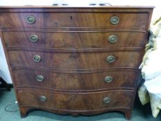 A GEORGE III MAHOGANY SERPENTINE FRONTED SECRETAIRE CHEST OF THREE GRADED LONG DRAWERS, THE WAVY