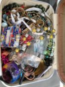 A SMALL VINTAGE SUITCASE CONTAINING A LARGE QUANTITY OF VINTAGE AND MODERN COSTUME JEWELLERY AND