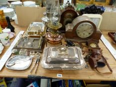 TWO SILVER PLATED TUREENS, AN ARTS AND CRAFTS OIL LAMP WITH MESSENGER BURNER, FIVE VARIOUS CLOCKS, A