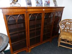 A MAHOGANY BREAKFRONT DISPLAY CABINET WITH FOUR LANCET ARCHED GLAZED DOORS ENCLOSING SHELVES ABOVE