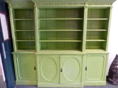 AN ANTIQUE APPLE GREEN PAINTED BREAKFRONT BOOK CASE, THE TOP WITH OPEN SHELVING BETWEEN REEDED PILAS