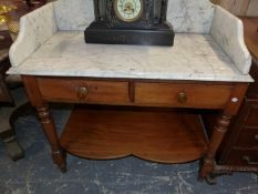 A VICTORIAN WHITE MARBLE TOPPED MAHOGANY WASH STAND WITH TWO DRAWERS ABOVE THE TAPERING CYLINDRICAL