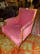 A PAIR OF FRENCH NEOCLASSIC FRUITWOOD SHOW FRAME ARMCHAIRS, THE SQUARED BACK ARMS AND SEATS UPHOLSTE