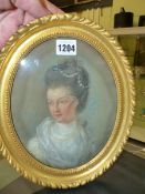 AN OVAL PASTEL PORTRAIT OF A GEORGIAN LADY WEARING PEARLS IN HER DARK HAIR, THE BACK INSCRIBED IN