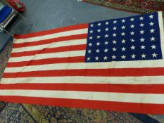 A UNITED STATES FLAG, FIRST HALF OF THE 20th C. PRINTED WITH 48 STARS. 139 x 268cms.