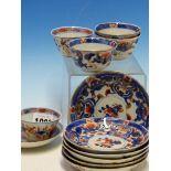 THREE CHINESE IMARI TEA BOWLS AND SIX SAUCERS, TWO OTHER CHINESE IMARI TEA BOWLS AND A JAPANESE