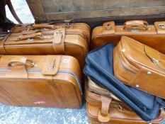 A COLLECTION OF TEN VARIOUS SIZE SUITCASES