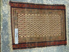 AN ANTIQUE PERSIAN TRIBAL RUG. 160 x 112cm TOGETHER WITH BELOUCH MAT, 112 x 79cm AND TWO TRIBL BAG