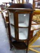 A EDWARDIAN BARBERS POLE LINE INLAID MAHOGANY CORNER CUPBOARD, THE BOW FRONTED DOORS ENCLOSING TWO
