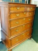 A GEORGIAN AND LATER OAK CHEST ON CHEST, THE UPPER PART WITH TWO SHORT AND THREE GRADED LONG DRAWERS