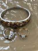 A VINTAGE DECORATIVE GILT PINK STONE SET BANGLE, AND TWO RINGS, ONE 9ct GOLD THE OTHER SILVER.