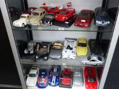A QUANTITY OF BRUAGO AND MAISTO MODEL CARS ETC.