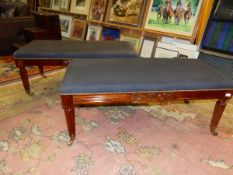 A PAIR OF MAHOGANY REGENCY STYLE BENCHES OR DOUBLE STOOLS, EACH WITH GREY UPHOLSTERED SEAT CLOSE NAI