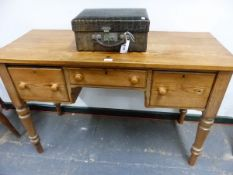 A VICTORIAN PINE THREE DRAWER SIDE TABLE ON TURNED LEGS. W 122 X D 50 X H 79cms.