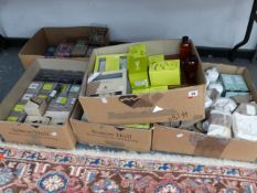 A LARGE QUANTITY OF SCENTED CANDLES, SHAMPOOS, ETC.