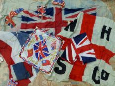 A UNION FLAG, THE SEPARATE COLOUR STRIPS SEWN TOGETHER. 10 x 210cms. A STRING OF BUNTING AND A