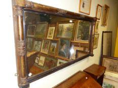 AN ANTIQUE RECTANGULAR MIRROR IN GILT COLUMNAR MOULDED FRAME. 69 x 135cms.