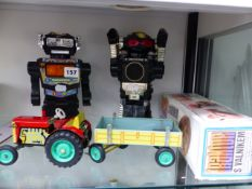 TWO VINTAGE BATTERY OPERATED ROBOT TOYS, AND A TIN PLATE TRACTOR AND TRAILER.