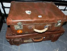 A LEATHER SUITCASE TOGETHER WITH ANOTHER SUITCASE
