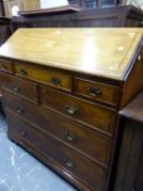 A GEORGIAN STYLE MAHOGANY BUREAU, THE FALL STAR INLAID ABOVE A CONFIGURATION OF SEVEN DRAWERS AND BR