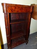 A PAIR OF REGENCY STYLE MAHOGANY OPEN BOOK SHELVES ON SPINDLE FEET. W 48 x D 25 x H 86cms.