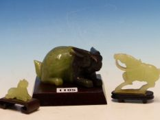 A CHINESE GREEN AND BLACK BOWENITE CARVING OF A RABBIT. W 13cms. TOGETHER WITH TWO GREEN STONE
