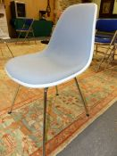 A SET OF EIGHT CHARLES EAMES DESIGN VITRA CHAIRS WITH GREY UPHOLSTERY WITHIN WHITE PLASTIC BACKS AND