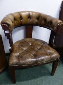 A BUTTONED LEATHER OAK DESK CHAIR WITH THE HALF ROUND BACK RUNNING INTO THE ARMS, THE SEAT ON