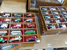 A COLLECTION OF VINTAGE DIE CAST ADVERTISING VEHICLES IN DISPLAY BOXES.