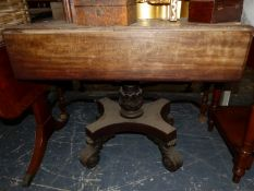 AN EARLY 19TH CENTURY MAHOGANY PEMBROKE TABLE ON A LEAF CARVED COLUMN ENDING IN A PLINTH ABOVE FOU