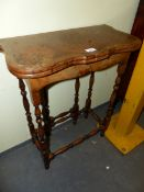 A CROSS BANDED BURR YEW WOOD TABLE WITH A SHAPED FLAP TOP OPENING ONTO A SINGLE GATE. W 58 x D 27