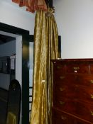 A PAIR OF LINED SILK CURTAINS WITH WHITE BAMBOO ON AN OLIVE GREEN GROUND, EACH DROP APPROXIMATELY