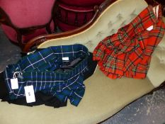 THREE LARGE KILTS AND A SECTION OF TARTAN FABRIC, TWO KILTS BY ROYAL MILE EDINBURGH. SIZE 46.