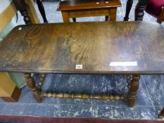 A RETRO OAK ROUNDED RECTANGULAR COFFEE TABLE. W 103 x D 47 x H47cms.