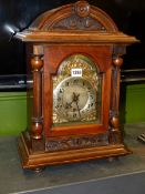 A MAHOGANY CASED WURTEMBERG MANTEL CLOCK, THE MOVEMENT STRIKING AND CHIMING ON FIVE RODS, PAPER