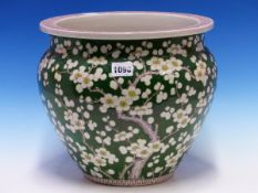 A CHINESE GREEN GROUND PLANTER PAINTED WITH CHERRY BLOSSOM, FOUR CHARACTER MARK IN RED. Dia. 27.5