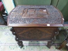 A BURMESE MAHOGANY COFFER, THE LID CARVED WITH A TEMPLE SCENE WITHIN FOLIAGE AND BIRDS, THE SIDES