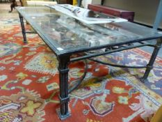A GLASS TOPPED IRON RECTANGULAR COFFEE TABLE, THE UNDERTIER WROUGHT WITH SCROLLS, LEAVES AND