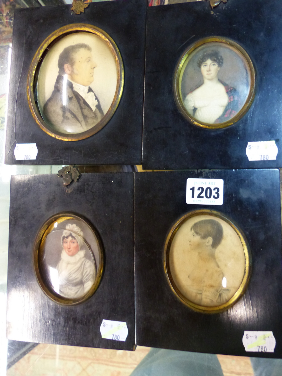 FOUR BLACK FRAMED PORTRAIT MINIATURES, ONE OF THE TWO PORTRAITS OF LADIES INSCRIBED ON THE BACK