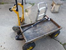 A FOUR WHEEL TROLLEY, TOGETHER WIT TWO SMALL SACK TRUCKS. (3)