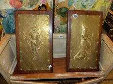 A PAIR OF ARTS AND CRAFTS BRASS RELIEF PANELS