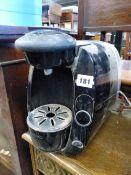 A TASSIMO COFFEE MACHINE.