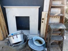A FIRE SURROUND, TWO SCULLERY STEPS, PANEL DOORS, GALVANISED BUCKETS, ETC.