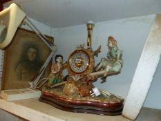 A CHINA CLOCK, CONVEX MIRROR, MAGNIFYING LAMP AND A PRINT. (4)